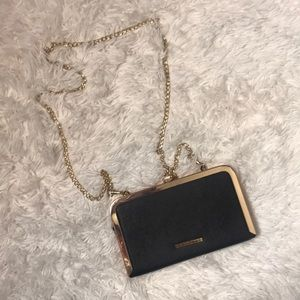 Black and gold chain handle clutch
